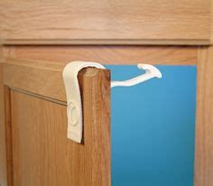 child proof kitchen cabinets rimiclip a new kind of painless child safety latch
