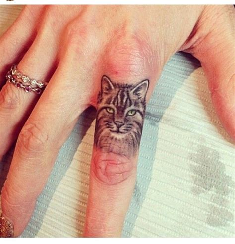cat finger tattoo small cat on finger