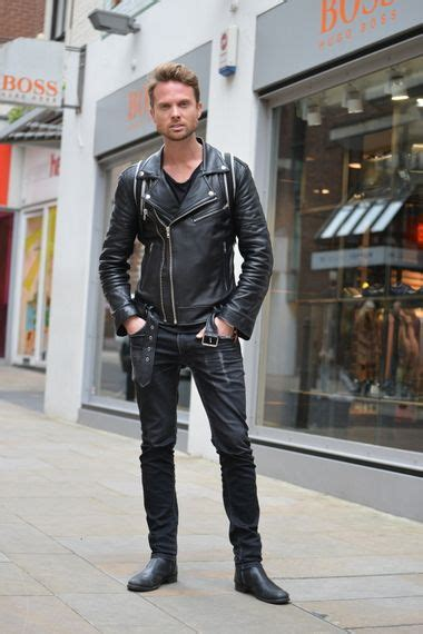 mens black biker style boots wearing black skinny jeans with black ankle boots with a