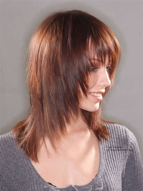 women medium tapered haircut long haircut with tapering and texture that frames the face