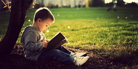 picture of a child reading a book ways to help fall in with books baby couture india