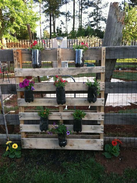 pallet flower bed repurposed pallet 2 liter soda bottle flower bed yard