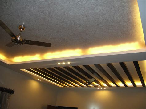Home Decor Trends In India by False Ceiling Design For Living Room With Two Fans