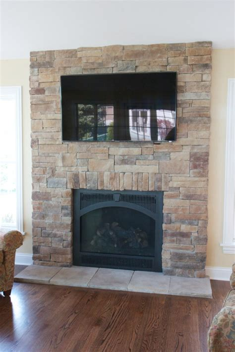 tv above fireplace heat fireplaces with tvs