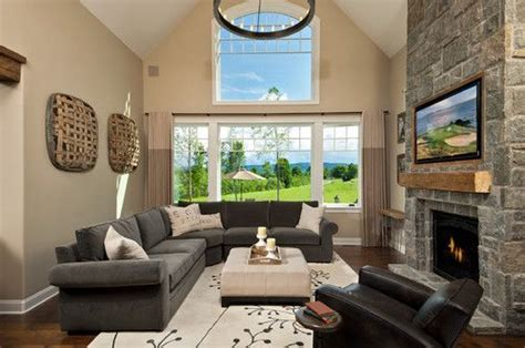 grey couch tan walls cream ottoman  carpet brown
