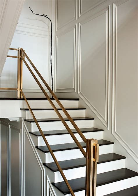 contemporary banisters and handrails paper city entrances foyers brass hand rail brass
