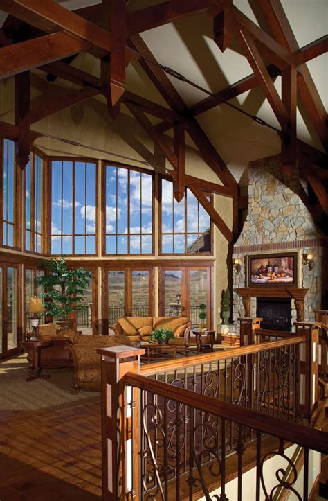 rustic lodge style great room is topped with wood beams