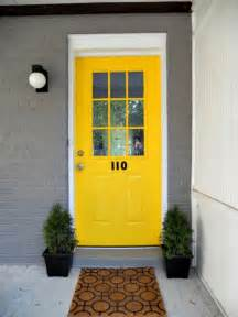front door colors for yellow house grab their attention with the bright yellow greeting for