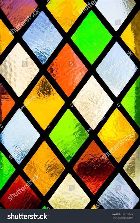 Colored Glass by Stained Glass Window Colored Glass Stock Photo 128121989