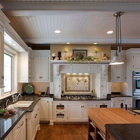 love  white wood panel ceiling kitchen remodel
