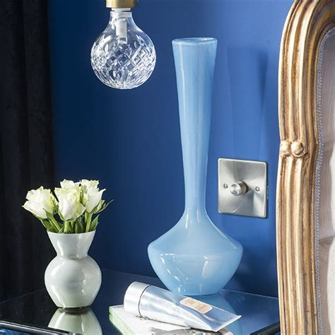 bedroom vases blue and white glass vases on a mirrored bedside table