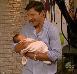 Baby s cozy position in her dad s arms she loves her daddy so much