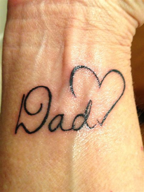father tattoo with small memorial on wrist