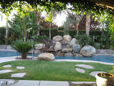 Tropical Landscape Ideas With Charming Swimming Pool Backyard With Pool Landscaping Ideas