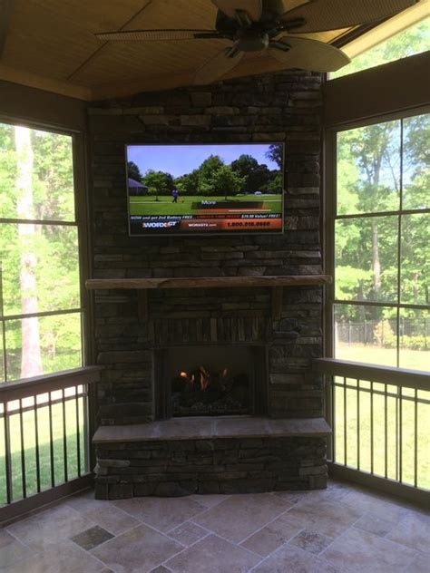 glass enclosed fireplace outdoor fireplace in screen porch with tv and eze breeze