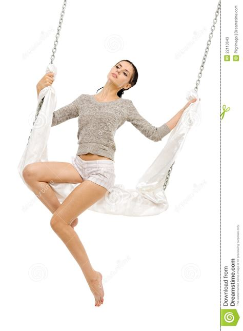 woman on a swing beautiful woman swinging on a swing stock photos image