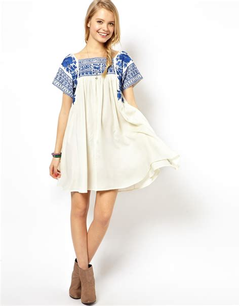 embroidered swing dress lyst asos premium swing dress with embroidery in natural