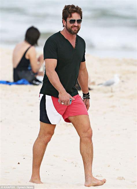 along with the gods sydney gerard butler hits sydney s bondi beach for a spot of