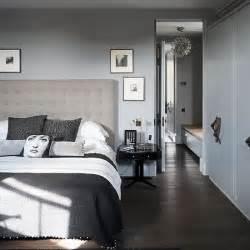 tonal grey bedroom with dark wood floor decorating