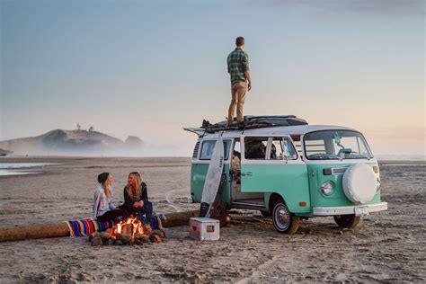 volkswagen bus beach friends hanging out around a beach fire on the oregon