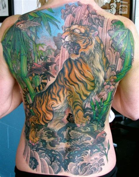 tattoo ideas jungle colourful jungle back tattoomagz