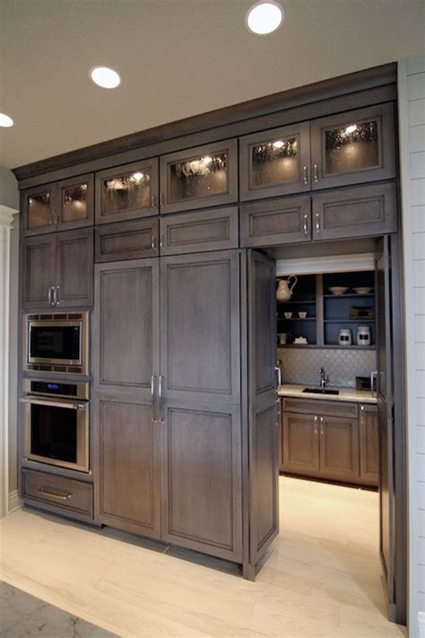 wall to wall kitchen cabinets hidden butlers pantry transitional kitchen