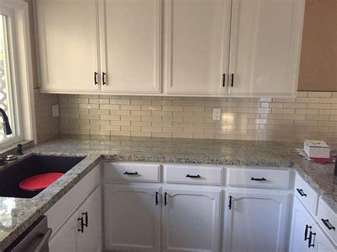 giallo fiorito granite with oak cabinets swiss coffee oak cabinets chagne glass mosaic