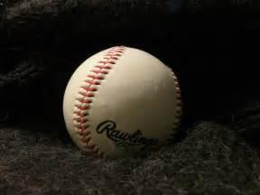 file baseball on black cloth jpg wikimedia commons
