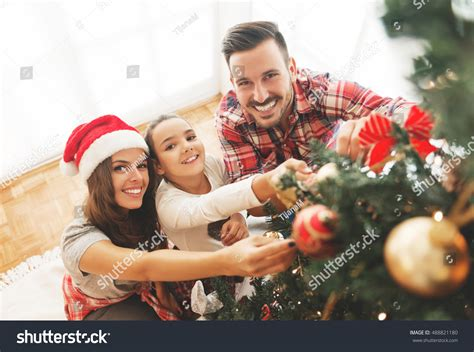 family christmas tree jarrettsville family decorating tree stock photo 488821180