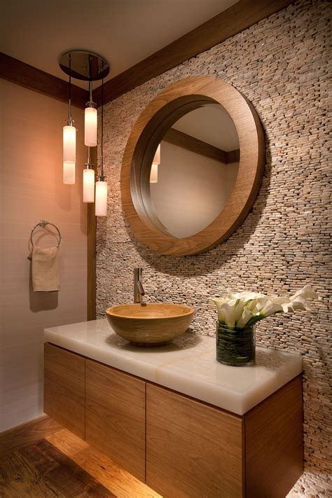 the powder room earth tones and textures inspire this space and make a
