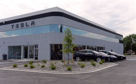 tesla opens a showroom and service center in the of
