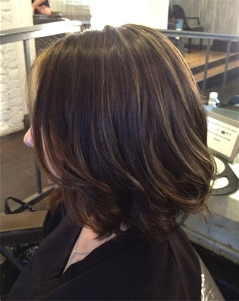 very short hairstyle with highlights lift and a bump on superfine brunette highlights neil george