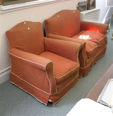 2 seater sofa and matching armchairs a two seater sofa in orange cover and matching armchai
