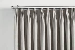 how to hang drapes on traverse rod master bedroom tailored pleat drapery on traverse rod