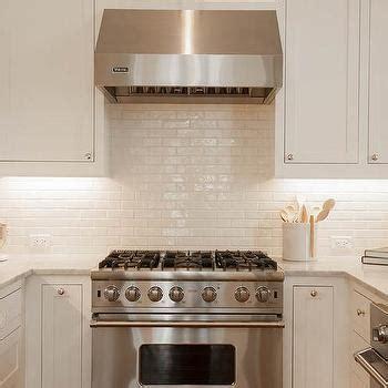 mini subway tile kitchen backsplash stacked white kitchen cabinets with italian carrera marble