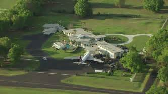 ms aerial of travolta house with airstrip in