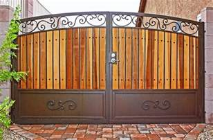 traditional iron and wood gate by first impression security doors traditional home fencing