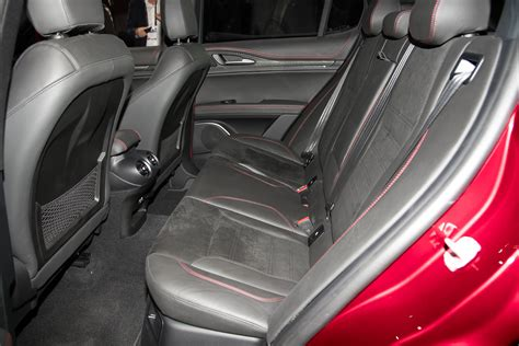 2018 alfa romeo stelvio rear interior seats motor trend