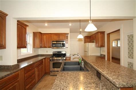 two tier island with sink and dishwasher would prefer house tweaking