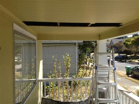 Hanging Swing From Ceiling by Hanging A Porch Swing Beadboard Ceiling A Dormer