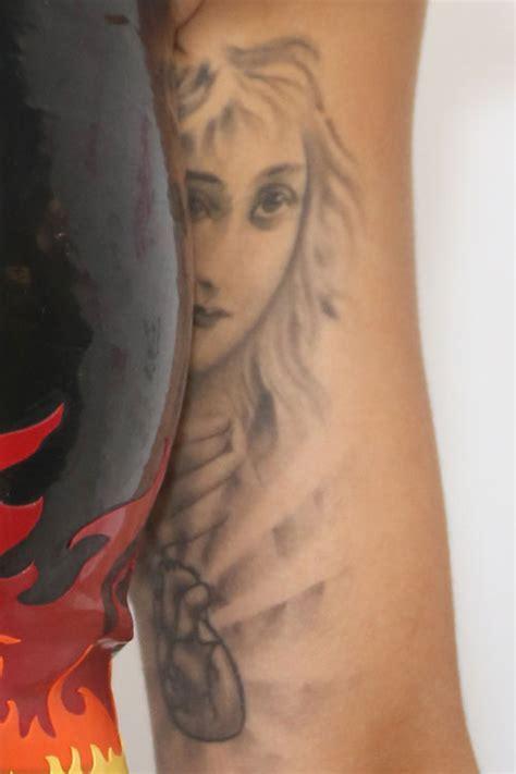 rita ora tattoo ora portrait bicep style