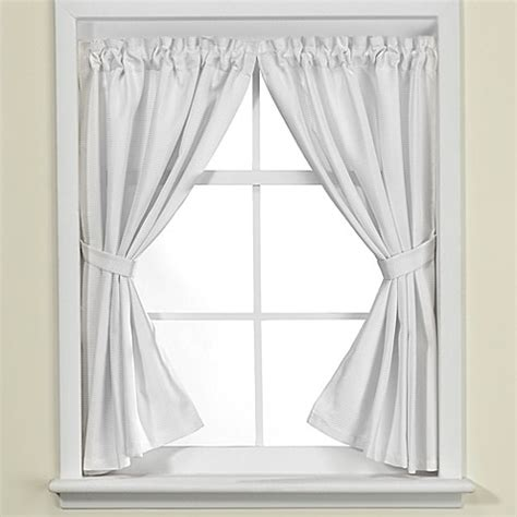 White Ruffle Curtain Panels Westerly Bath Window Curtain Pair In White Bed Bath Amp Beyond