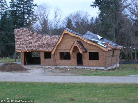 Size Of A 2 Car Garage chris whited man builds real life hobbit house complete