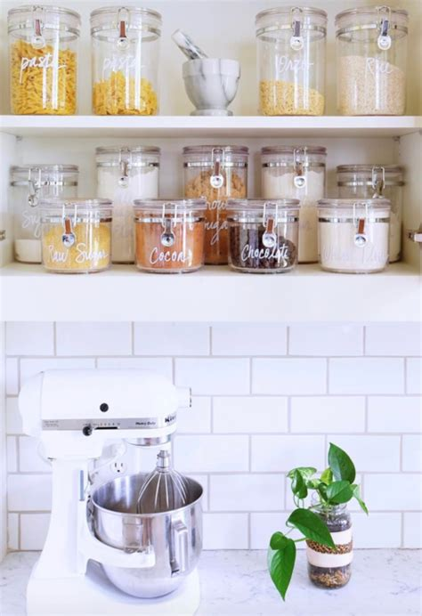15 beautifully organized kitchen cabinets and tips we learned from each organization 28 organized home kitchen cabinets and kitchen