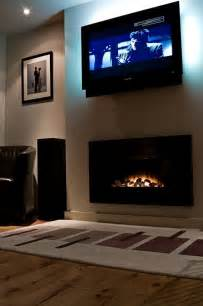 tv wall mount fireplace look tv mounted above fireplace apartment therapy