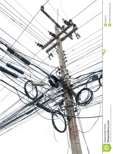 how to isolate live wires chaotic tangle of wires on electric post royalty free