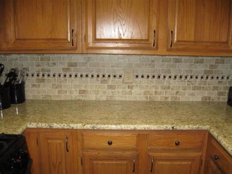 Montagna Cortina backsplash from home depot and Giallo