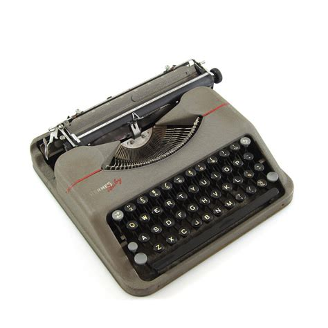 Hermes Baby portable typewriter with case (1943)