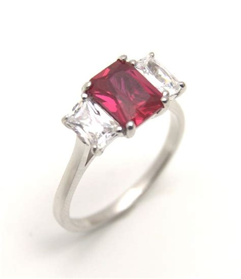 unique ruby 3ct emerald cut trilogy ring