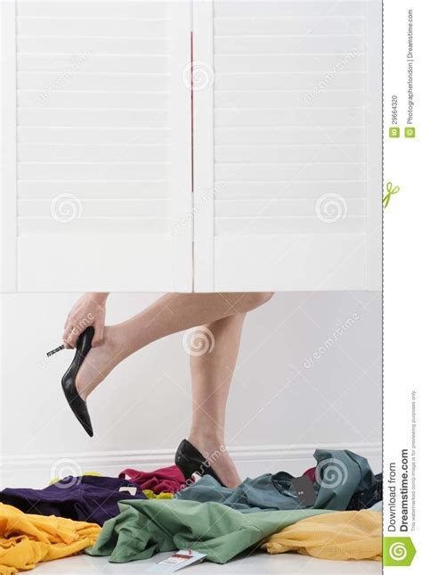 sectioned laundry her woman removes high heels in fitting room stock photo